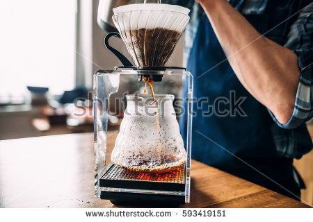 "Man prepares coffee in style ""pour over""  in barista school."