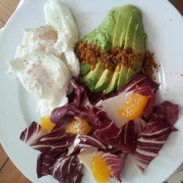 poached eggs w/ avo and wanut dukkah and a radichio and orange salad