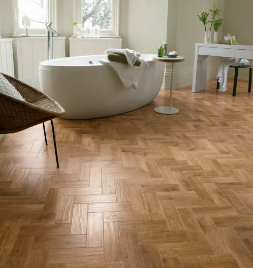 Blond oak parquet Karndean flooring.  Karndean gives you a wood looking floor in your bathroom but without the worry of water damage.