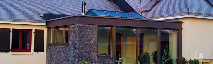 extanxia, véranda concept alu, vue extérieur avec toit en ardoise et cheminée intégrée