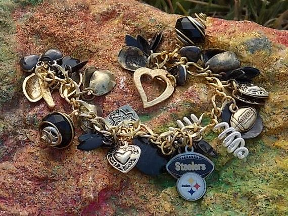 Hey, I found this really awesome Etsy listing at http://www.etsy.com/listing/162028890/pittsburg-steelers-charm-bracelet-team