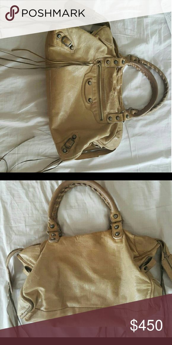 Authentic balenciaga bag Used balenciaga bag in camel. Bag has some discoloration but since it's camel color it doesn't look too bad. Balenciaga Bags
