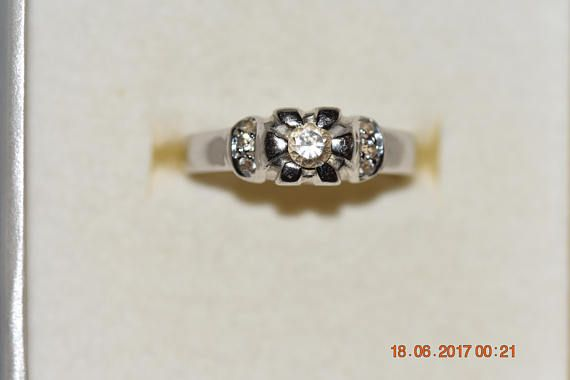 14kt white gold ring with zircon size 53