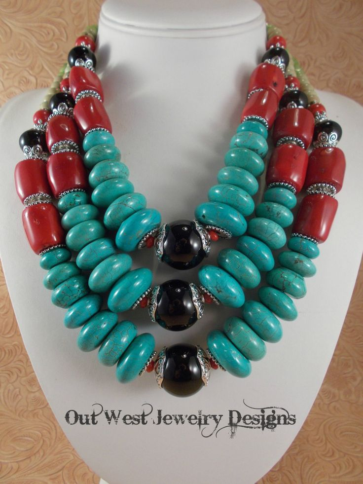 Take a look at this fabulous, triple strand, statement necklace. I put it together using some large, lipstick red branch coral nuggets, smaller coral rondelles, turquoise howlite disks in graduated sizes, black, brown and khaki colored howlite disks and rondelles, small, faceted dyed green jade rondelles and some shiny black agate rondelles and rounds. Lots of premium Tibetan silver spacer beads and bead caps. This piece has a striking tribal or Southwest look to it. A big, decorative…