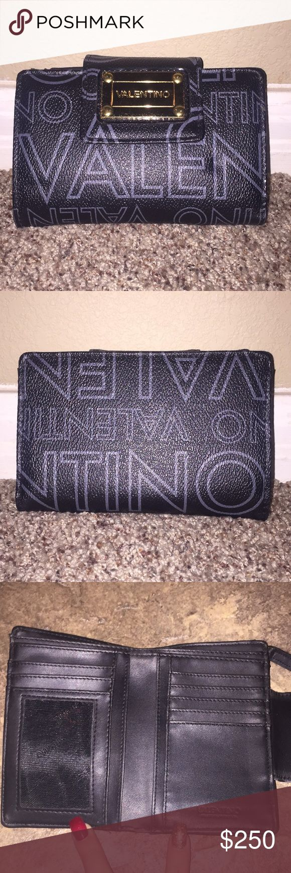 Authentic black Valentino wallet 😍😍 100% authentic. Amazing condition. Only flaw is minor wear on hardware. Other then that it's perfect . Valentino Bags Wallets