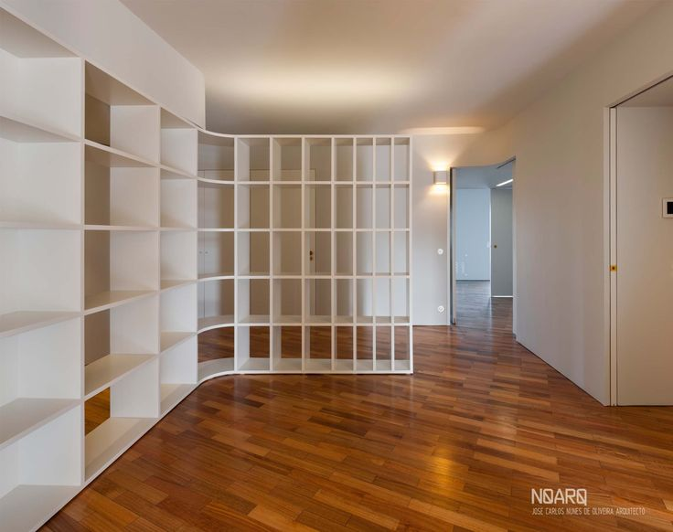 NO APARTMENT - Living room, view from kids bedroom and the entrance - #noarq # renovation #living #shelves #light #greydesign #whitedesign #woodfloor - by José Carlos Nunes de Oliveira - © NOARQ - Photography by Arménio Teixeira