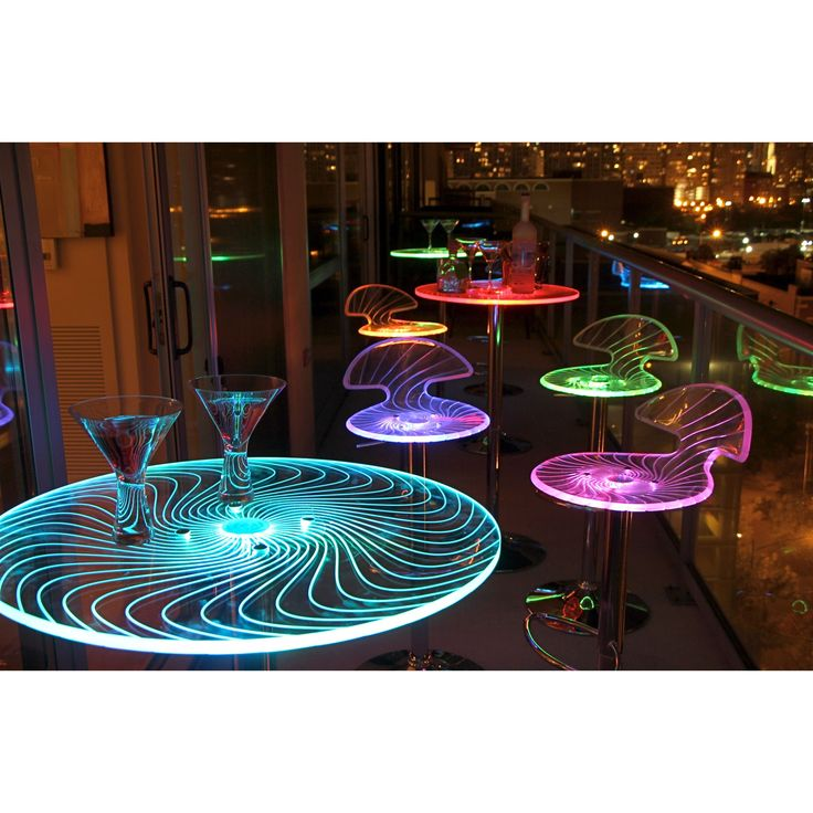 This Spyra LED Light-up Bar Table features a colorful splash of light and shapes. The etched acrylic table top makes this a great party table.