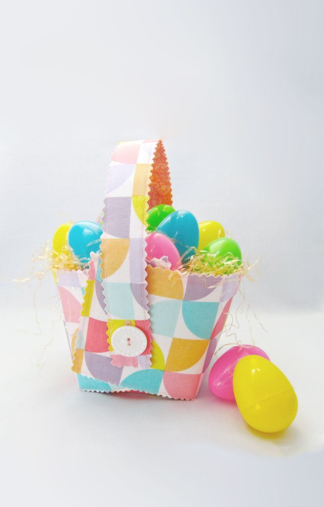 Sew a collapsible Easter basket that your kids can use every year with this Collapsible Fabric Easter Basket tutorial! Homemade Easter baskets like this one add a little extra nostalgia to the holiday. The basket shown here is made in white and bright pastels, perfect colors for spring. If you thought making Easter baskets was hard, read these detailed, illustrated instructions to learn how to make a professional-looking DIY basket.