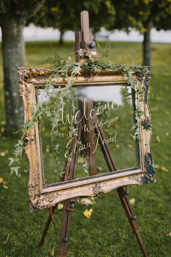 Welcome wedding sign on glass in gold frame / http://www.himisspuff.com/mirror-wedding-ideas/5/