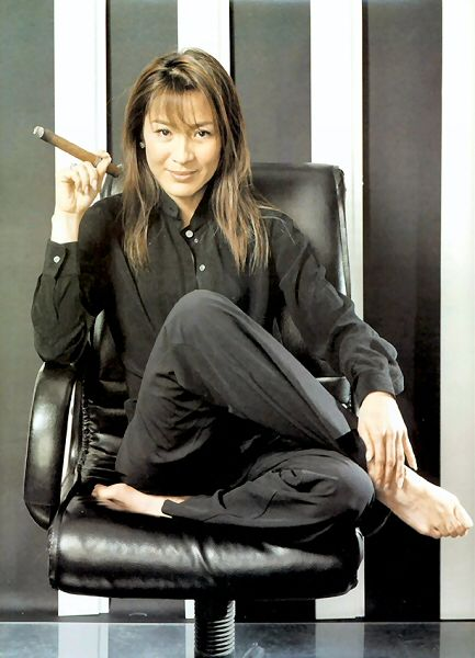 Michelle Yeoh, an ageless beauty...her martial arts movies makes her.... well, just plain sexy!