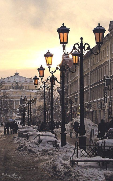 Winter street in St. Petersburg, Russia. Beautiful winter yellow sky.