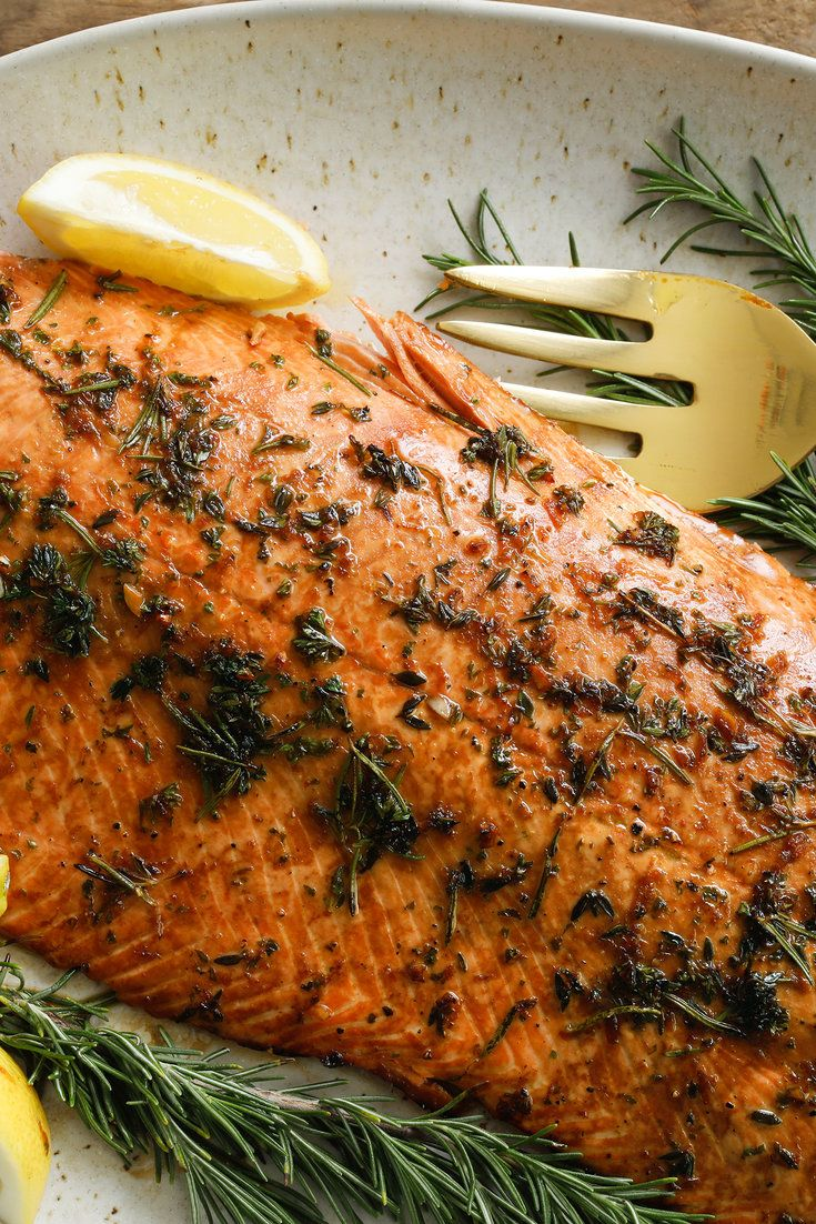 "NYT Cooking: Here's one of the easiest ways to entertain: broil or grill a large salmon fillet, then adorn it with lemon wedges and rosemary sprigs. This recipe marinates the rich salmon in lemon juice, soy sauce and herbs. Serve it with a sharply flavored potato salad (like <a href=""https://cooking.nytimes.com/recipes/5823-alice-rose-georges-potato-watercress-salad"">this one, with red Bliss potatoes ..."