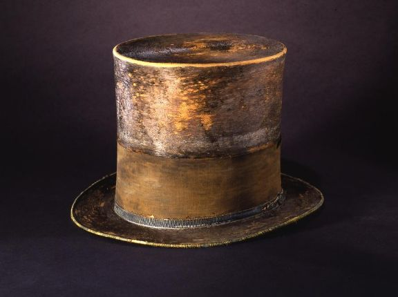 At six feet four inches tall, Lincoln towered over most of his contemporaries. He chose to stand out even more by wearing high top hats. He acquired this hat from J. Y. Davis, a Washington hat maker. Lincoln had the black silk mourning band added in remembrance of his son Willie. No one knows when he obtained the hat, or how often he wore it. The last time he put it on was to go to Ford's Theatre on April 14, 1865.After Lincoln's assassination, the War Department preserved his hat and other…