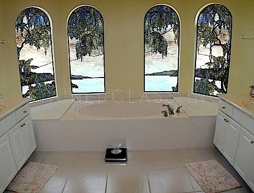 Imagine relaxing in a hot tub and looking out over the lake with complete privacy. This is a Tiffany Style Pale Blue Wisteria Stained Glass window.