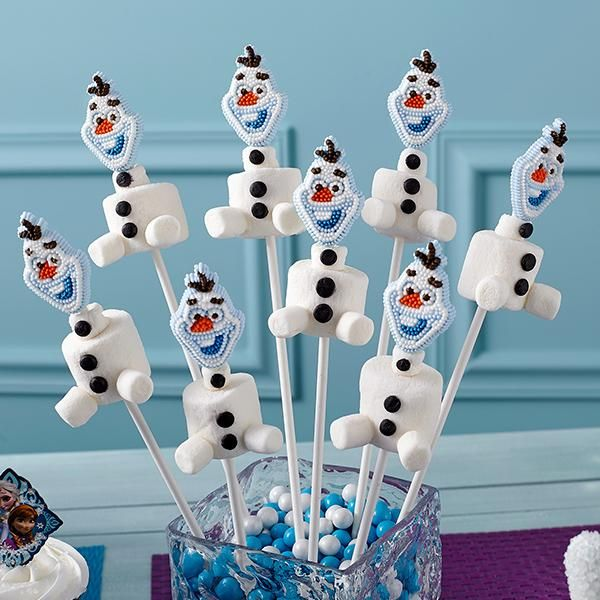 Make Olaf Marshmallow Treats - It is easy to build an Olaf snowman treat for your Frozen celebration.  Use Wilton Frozen Icing Decorations, Wilton Candy Melts Candy and marshmallows and Olaf appears!
