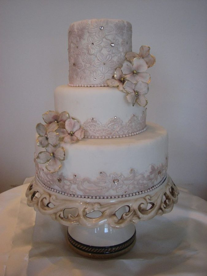 """* MAGGIE....an elegant and tasteful wedding cake with elements of fondant """"lace"""", gumpaste blossoms and gems."""
