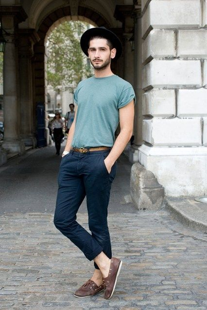 Shop this look on Lookastic: https://lookastic.com/men/looks/crew-neck-t-shirt-chinos-boat-shoes-hat-belt/1620 — Black Hat — Blue Crew-neck T-shirt — Brown Leather Belt — Navy Chinos — Dark Brown Leather Boat Shoes