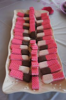 awww...I want to make these or maybe I just want another grandchild  chocolate dipped pink wafers - baby shower food