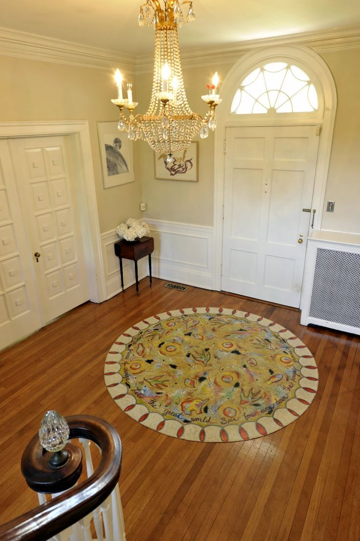 """""""Let the Great World Spin"""" circle floorcloth in the foyer."""""""
