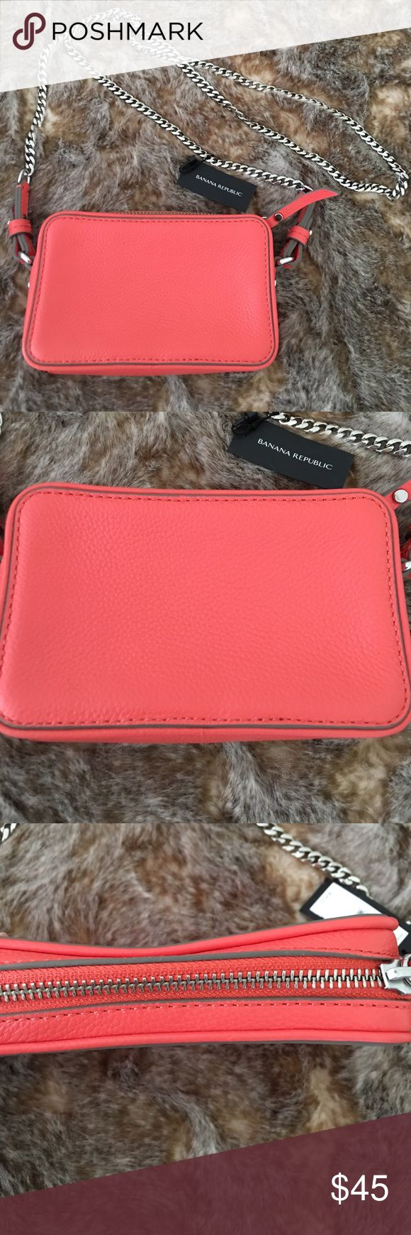 ⭐️HP⭐️NWT Banana Republic Coral Mini Crossbody Bag ⭐️HOST PICK ⭐️ Best in Gifts 🎁  NWT Banana Republic Brand. Coral Pink Mini crossbody purse /handbag. Chain for strap. Pockets inside for credit cards. 6 inches long 4 inches across. It can fit the 6s but not 6S plus. Strap is about 22 inches long. Banana Republic Bags Crossbody Bags