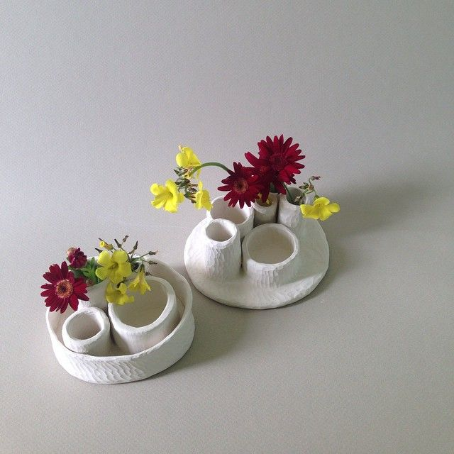 Porcelain foraging vessels by Hearth Collective.