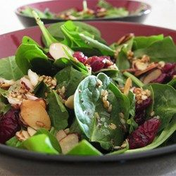 Jamie's Cranberry Spinach Salad - Allrecipes.com Wow, fantastic! I used Craisins and only 1/4 cup sugar. I also used light olive oil instead of vegetable and toasted the sesame seeds and almonds in the oven at 350 for 10 minutes to cut out the butter. Added gorganzola cheese and it was gobbled up at a potluck - they pratically licked the bowl! Thanks for the great recipe.