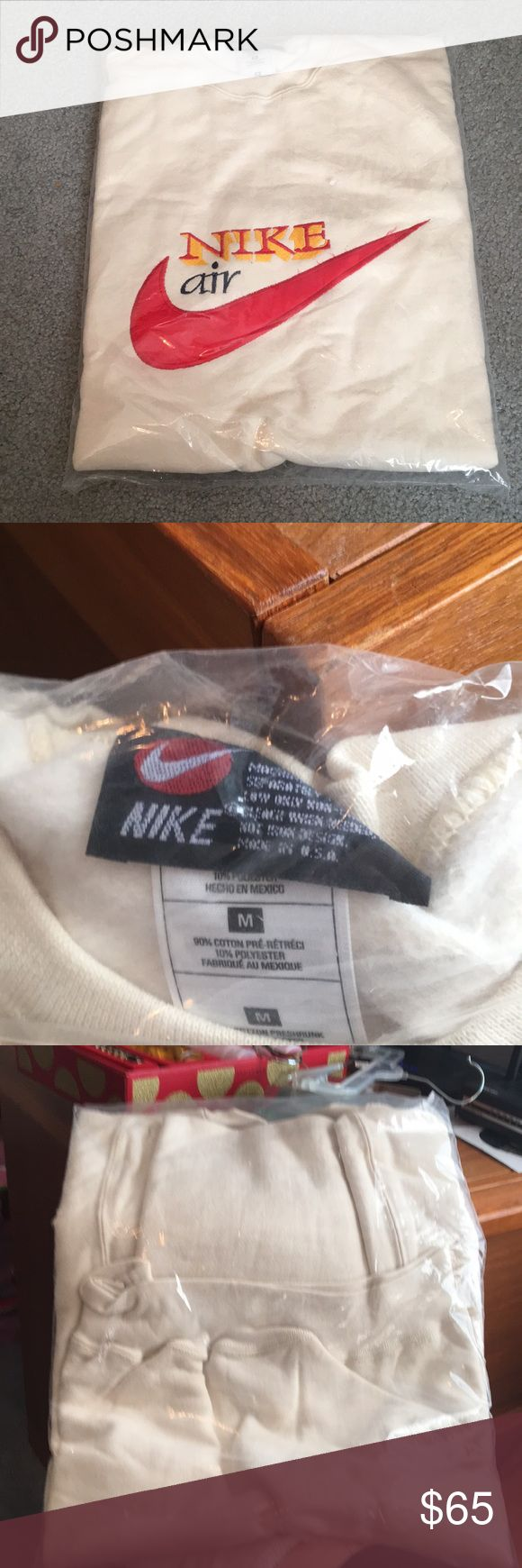 NWOT Nike air sweatshirt men's Medium This sweatshirt is in its original package. Never opened. I left the package closed so no photos of the entire things. nike air Jackets & Coats