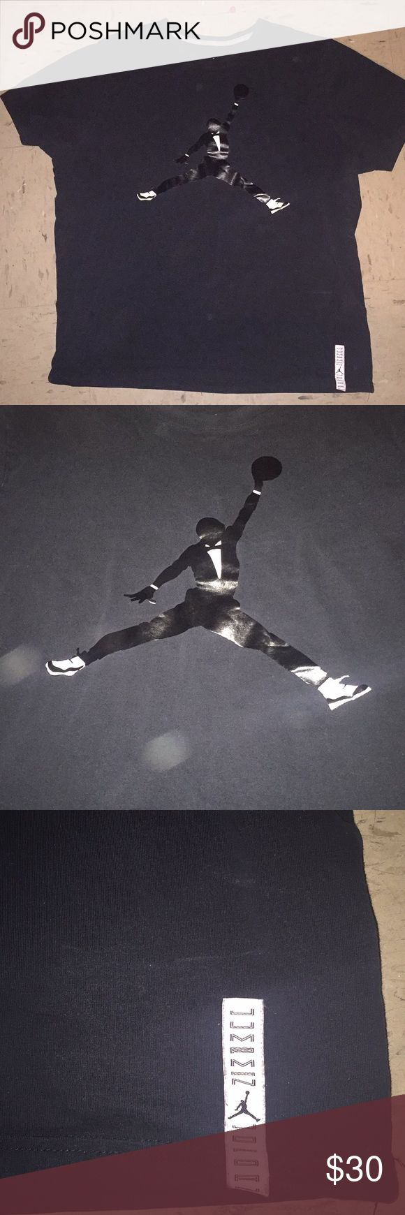 jordan logo tee a black t-shirt with the best to ever play basketball in michael jordan in his famous pose for the jordan brand logo. hes wearing a suit and the 11s on. size is XL. if u have them space jam 11s then this shirt is a perfect match. buy now or best offer..... Jordan Shirts Tees - Short Sleeve