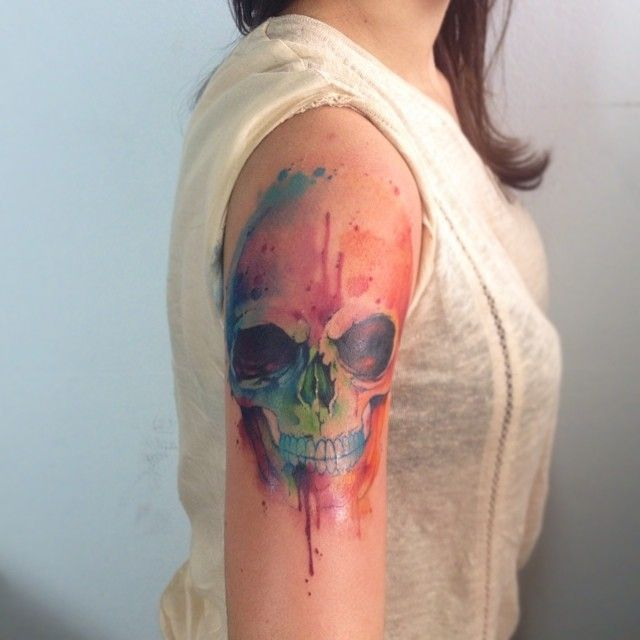 feminine watercolor skull tattoo