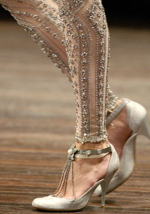 Alexander McQueen -  Check out those beyond cool pumps with chain fringe and some hottie pair of pants!