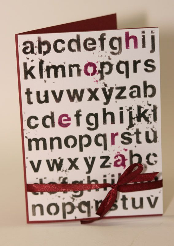 """Memorybox stencil """"Worn out"""" aphabet with in red the word """"hoera"""" (hurray) and same tone ribbon and cardstock, the stencil is raised with Wendi Vecchi translucent embossing paste"""