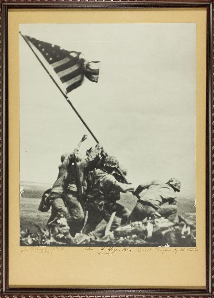 "((IWO JIMA FLAG RAISERS) IRA H. HAYES, RENE GAGNON AND JOHN H. BRADLEY  A rare signed item, combat photographer Joe Rosenthal''s iconic image ""Raising The Flag on Iwo Jima"", 10 1/4"" x 12 3/4"". The photo is mounted to a cardstock backing, with flag raisers IRA H. HAYES (1923-1955) ""Ira H. Hayes Pfc. U.S.M.C."" and RENE GAGNON (1925-1979) ""Rene A. Gagnon Pfc. U.S.M.C."" signing on the mount beneath the image. The mount is also signed by JOHN H. BRADLEY (1923-1994) ""John H. Bradley Pfc. M2/C U.S…"