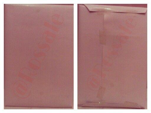 Tampak depan dan belakang barang yang telah dibungkus dengan pelapis kedua sebagai lapisan akhir.