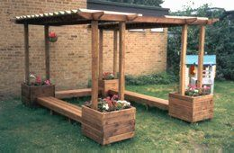 Pergola with benches and flowerpots.