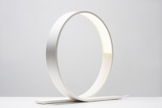 Loop, by Timo Niskanen, is minimalist LED table lamp. It is designed to endure time through its pure design language intended to counter constantly changing fashions and trends, as well the use of LED as a light source.