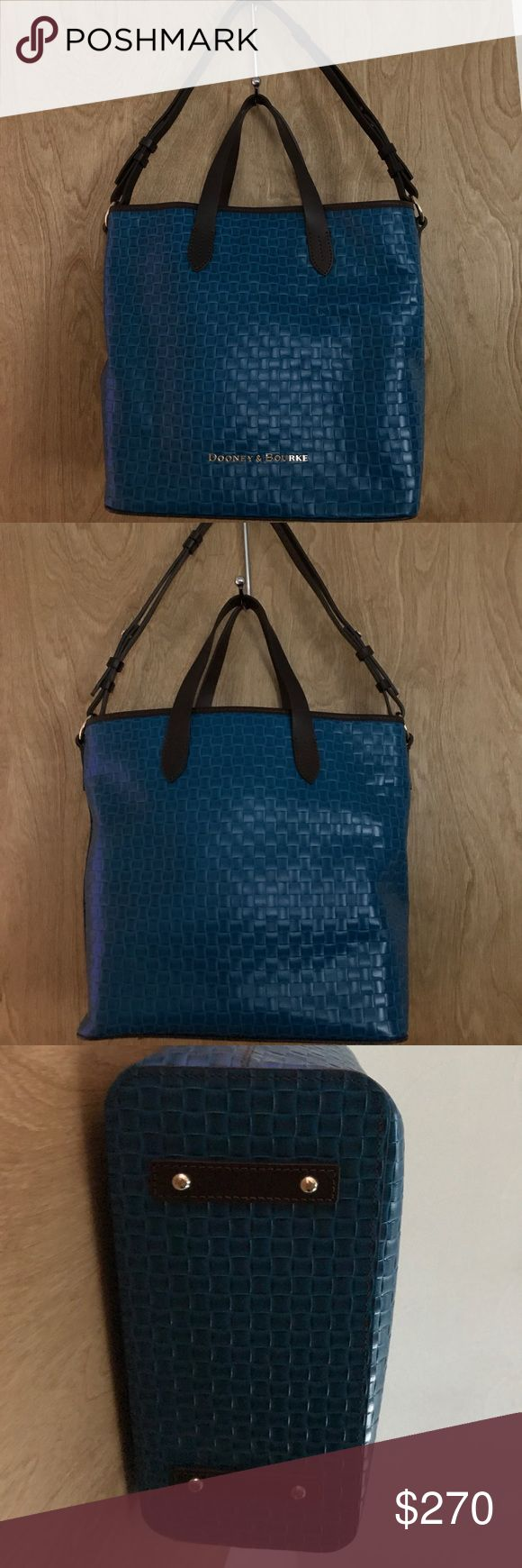 Dooney & Bourke Woven Embossed Leather Shopper Dooney & Bourke Woven Embossed Leather Shopper in Teal. Authentic Dooney & Bourke Shopper had embossed woven texture with dark leather trim & goldtone hardware. Snap closure & interior red lining. Interior has backwall zip & slip pockets, front wall has 2 slip pockets & key keeper & middle divider pocket has zip top closure. Measurements: 12.5 x 11.5 x 5.5 with 11in strap drop & handles are 5.5 drop. Gently used, small creases on front of bag…
