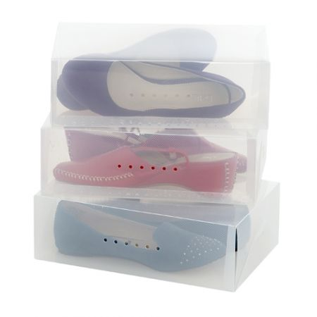 Acrylic see-through shoe boxes from Howard's Storage World.  I store all my seldom-used shoes in these, on the wardrobe shelf out of the way of daily use. You can easily see which shoes are inside, but the frosted design tones down the riot of colour.