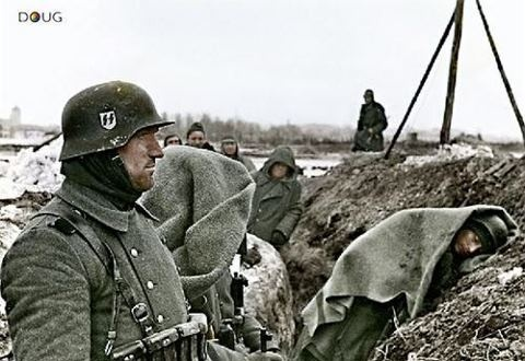 German SS troops defend a trench somewhere on the eastern front. 1942.