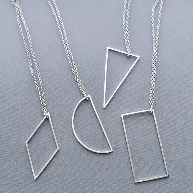 Geometric shape pendants in silver // Minimal luxe handmade jewellery by Elin Horgan