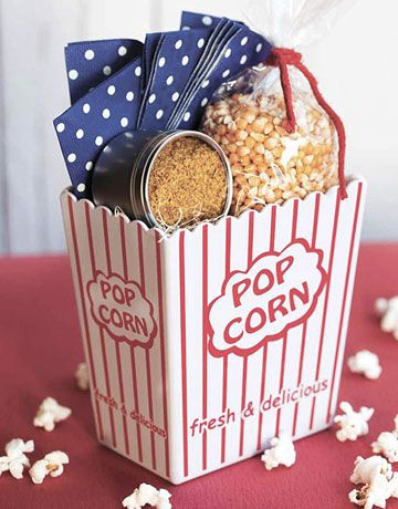 "Cinema Night Gift Basket Idea - Popcorn, seasoning salt & reusable plastic ""popcorn"" container. Containers can be obtained at the Dollar Tree or Dollar Store."