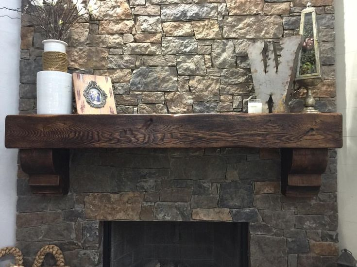 We build custom fireplace mantels from cedar beams The corbels are also cut from a cedar beam