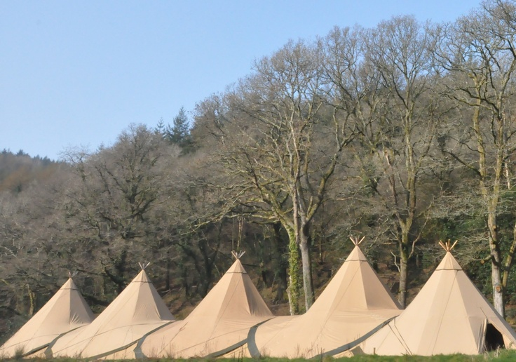 Winter company event at http://www.broomhillart.co.uk/                     Five Giant Hat tipis configured in a line