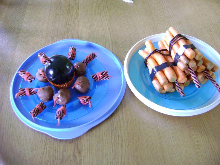boevenfeestje...bommetjes ( soesjes met een rode snoepveter) en dynamiet van dropstaafjes. voor de juffen gezond....pakketje dynamiet van wortels met dropveters erom ( en stukje schoon zwarte plakband) en dropstaaf als aansteeklont