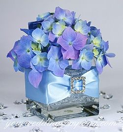 Purple hydrangea centerpiece with ribbbon and rhinestone buckle accent. #wedding #centerpiece #reception  Flyboy Naturals offers fresh hydrangea & eco-friendly hydrangea petals!