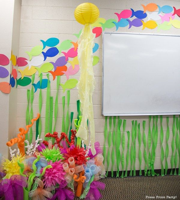 School of fish and fake coral. How to Make a Stunning Coral Reef for your Under the Sea Party, Mermaid Party, or VBS. By Press Print Party #OceanCommotion #Underthesea #mermaid Decorations