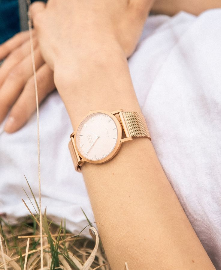 Gold watch and white face//