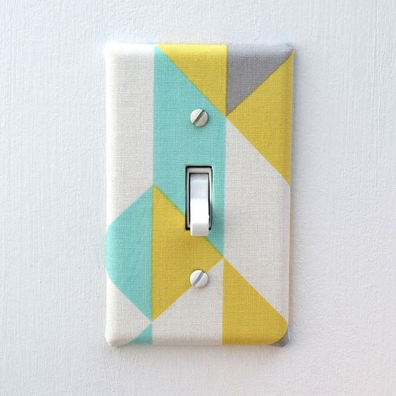 Fabric over light switch cover - can make one from the pinstripes or baseball fabric for the sports room