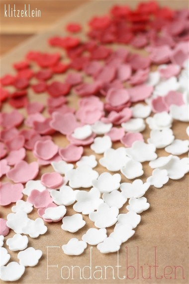 fondant flowers - great idea to use on a cake. Ice the cake with fondant, then cover with these flowers for an ombre effect
