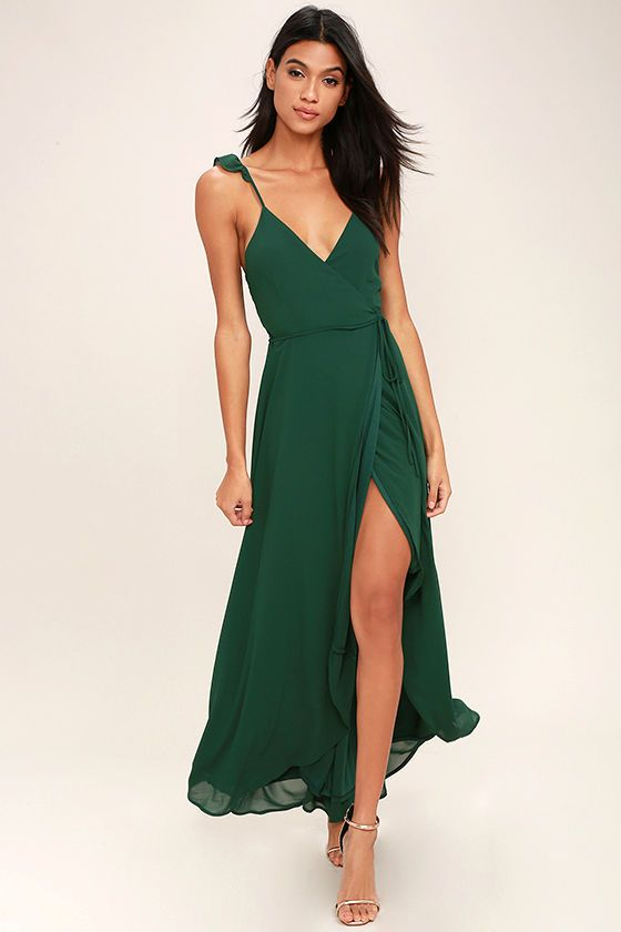 Toast to the weekend in the Here's to Us Forest Green High-Low Wrap Dress! Breezy woven fabric sweeps over a sleeveless wrap bodice with adjustable spaghetti straps, modified racerback, and tying waist sash. High-low maxi skirt has a front slit and rounded hem.