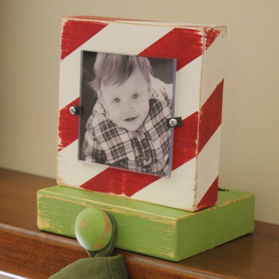 Stocking Holder. Totally DIY just using the little photo corner holders and change them out every year.